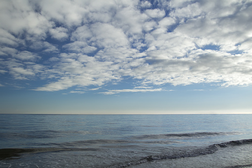 Heaven with stratocumulus clouds over sea