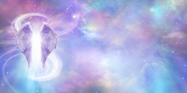 Heavenly Angel Spirit Banner a pair of Angel Wings with a swish of white energy behind set against a wide vivid cosmic Universe background with copy space angelic stock pictures, royalty-free photos & images
