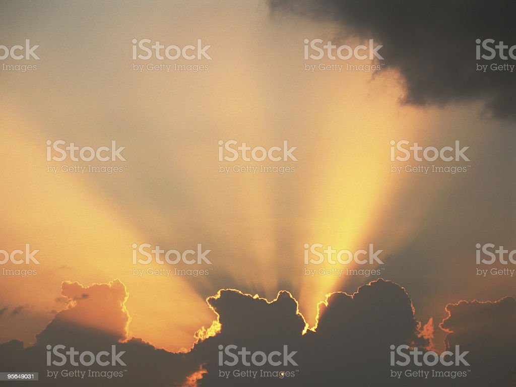heavenly scene of dramatic orange clouds and golden rays royalty-free stock photo