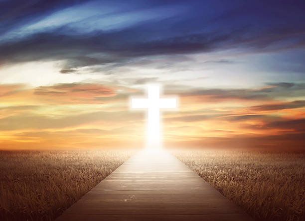 Heaven's Way Empty path on the field going to christian cross religious symbol stock pictures, royalty-free photos & images