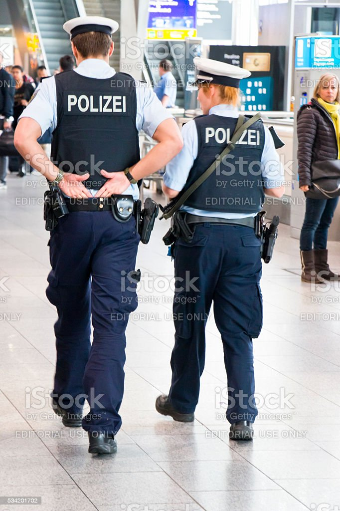 Heavily Armed Police Patrolling in Airport Lobby stock photo