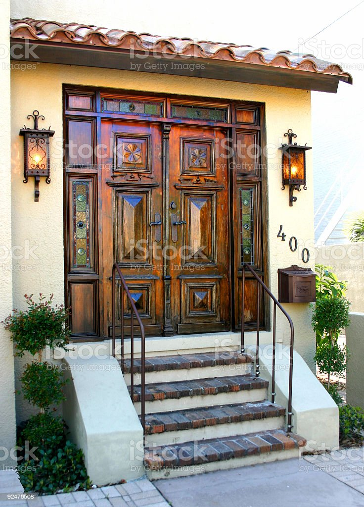 Heavily carved wooden door royalty-free stock photo