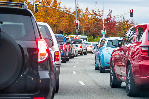 Heavy afternoon traffic in Mountain View, Silicon Valley, California; cars stopped at a traffic light
