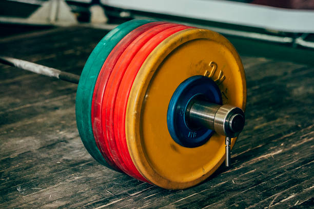 heavy barbell with five plates stock photo