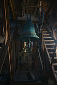 istock Heavy bell in the tower of the town church of Gadebusch, is ringing at worships and Christian holidays like Christmas and Easter 1290775935