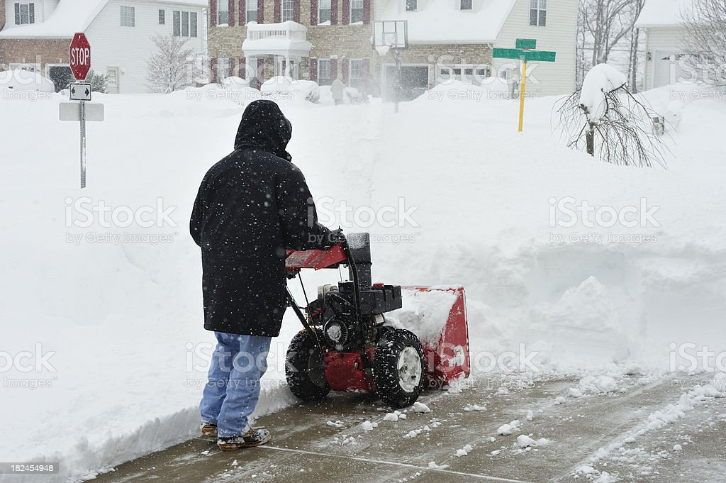 Heavy Blizzard Snowfall being removed by Snowblower stock photo