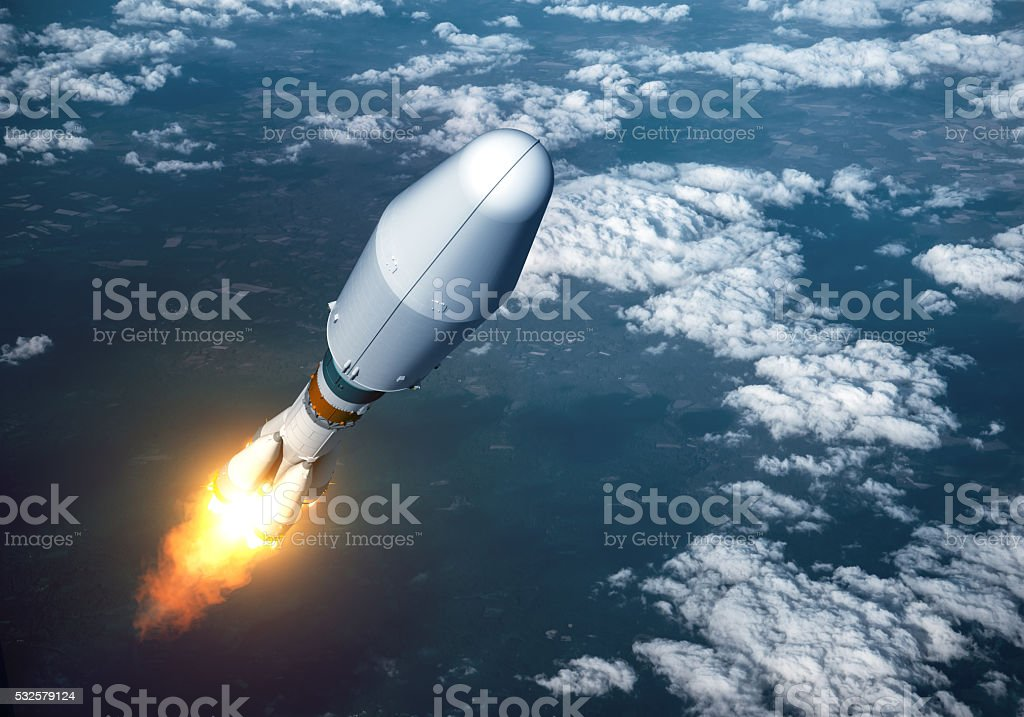 Heavy Carrier Rocket Launch In The Clouds stock photo