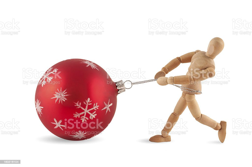 Heavy christmas job - Wooden mannequin at work royalty-free stock photo