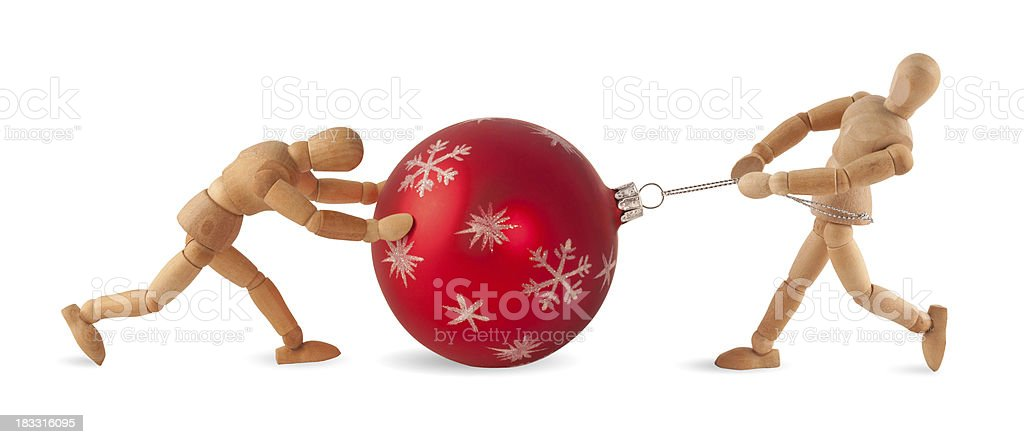 Heavy christmas job - Wooden mannequins at work royalty-free stock photo