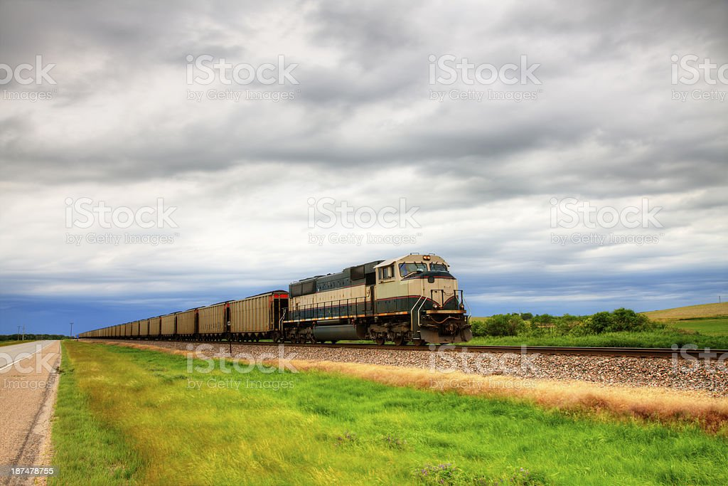 Heavy coal train in storm stock photo