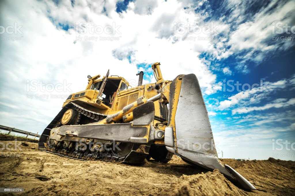 Heavy duty road building machine -  vehicle. stock photo