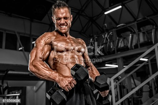 618209684istockphoto Heavy Duty Workout at the Gym 619369606
