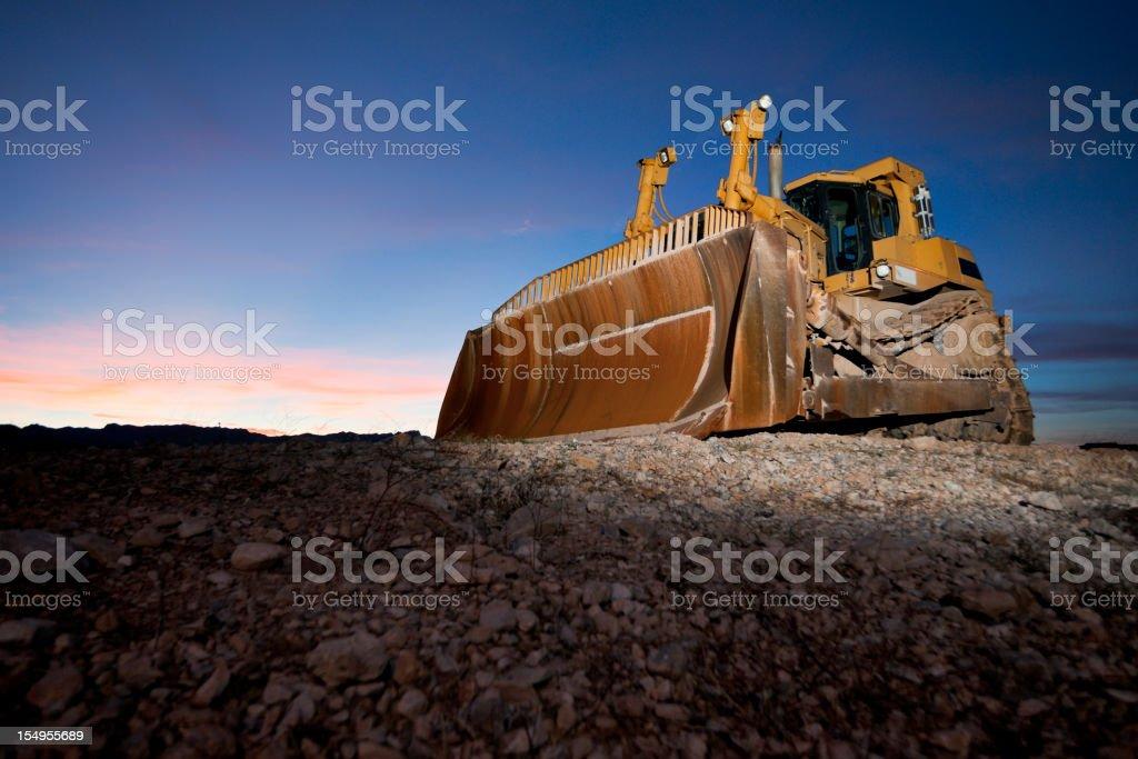 Heavy Equipment Bulldozer at Sunset stock photo