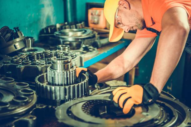 Heavy Equipment Parts Heavy Equipment Parts. Professional Mechanic Looking For Bulldozer Transmission Elements and Other Part. vehicle clutch stock pictures, royalty-free photos & images