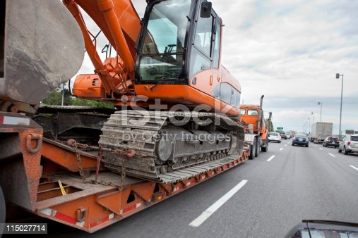 Flatbed Transport Truck Carrying Heavy Equipment.