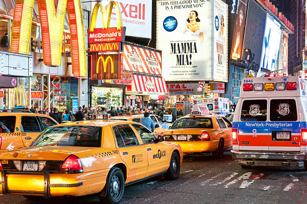 heavy evening traffic on times square - mamma mia stock photos and pictures
