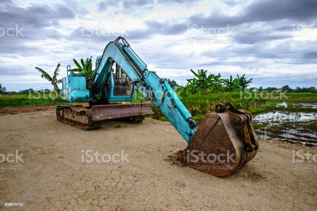 heavy excavator with shovel standing on hill stock photo