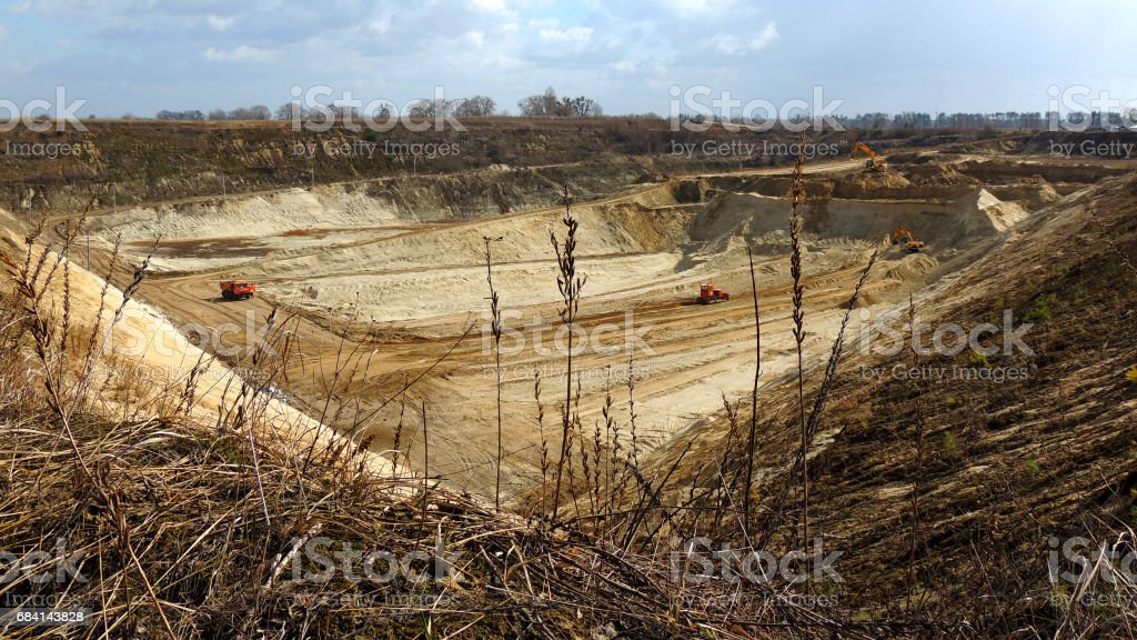 Heavy excavators and bulldozer works into industrial sand quarry foto stock royalty-free