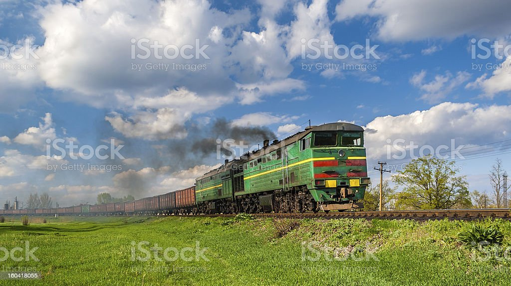 Heavy freight train hauled by diesel locomotive royalty-free stock photo