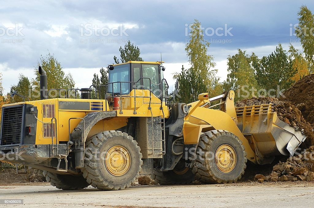 Heavy front loader in action stock photo