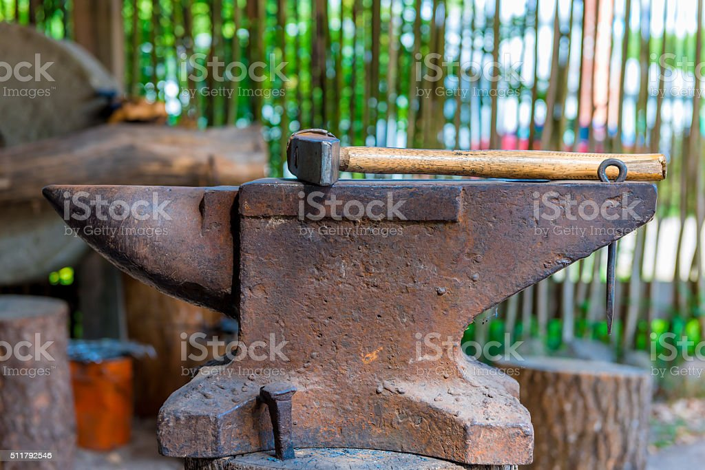 heavy hammer on the anvil in the forge close up stock photo
