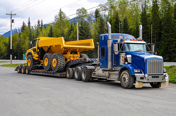 heavy hauling - carrying stock pictures, royalty-free photos & images