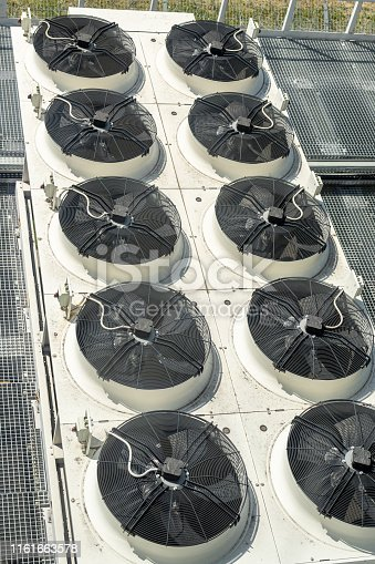 912000730 istock photo Heavy heating ventilation cooling and air conditioning set system on roof top of big industrial building 1161663578