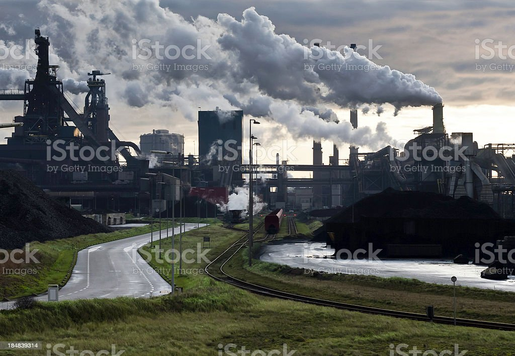 heavy industry with green grass foreground stock photo