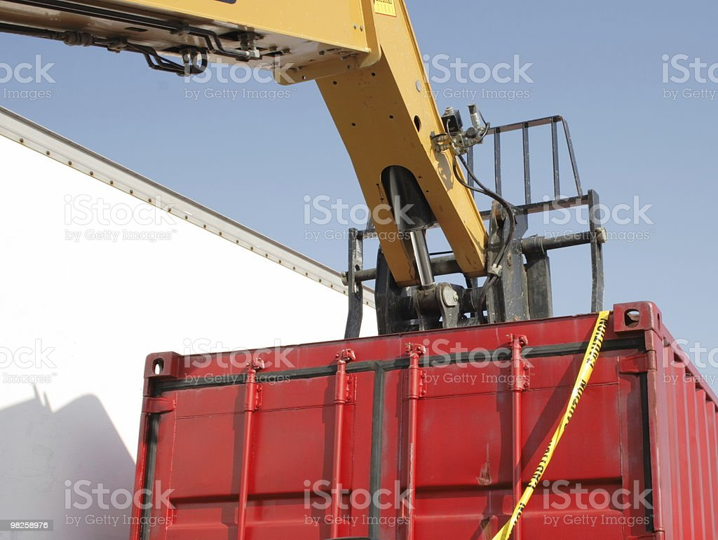 heavy lifter on top of red container royalty-free stock photo