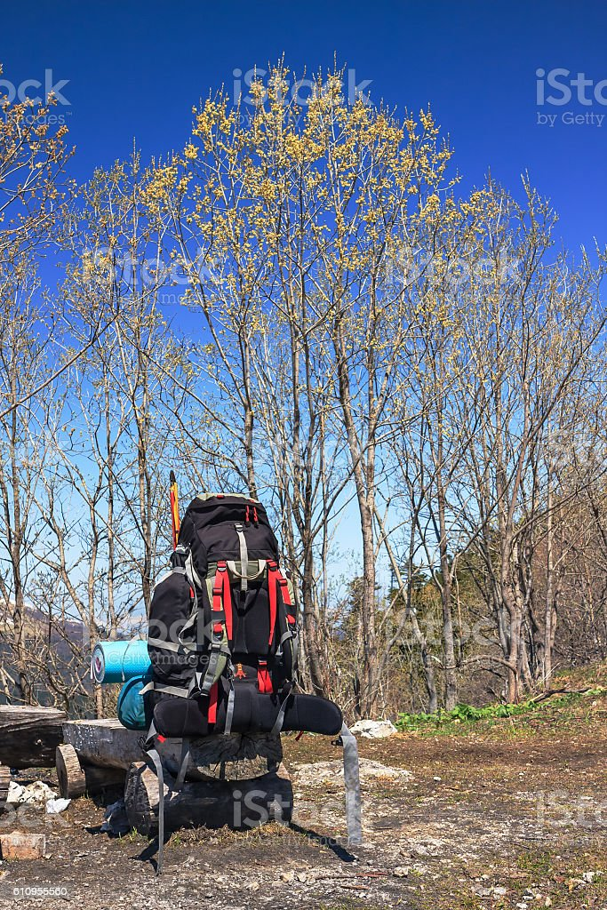 Heavy loaded backpack prepared for a hike on natural background stock photo