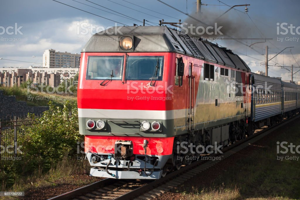 Heavy locomotive on railway in the city close up. stock photo