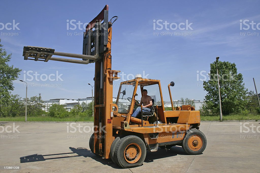 Heavy machine and worker royalty-free stock photo