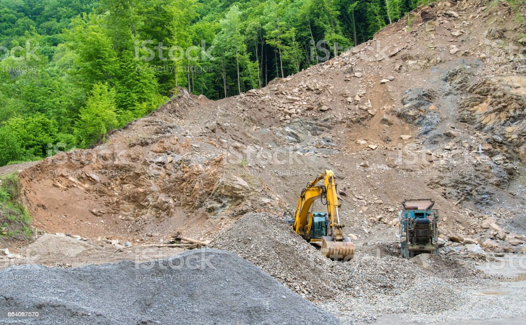 Heavy machinery in quarry royalty-free stock photo