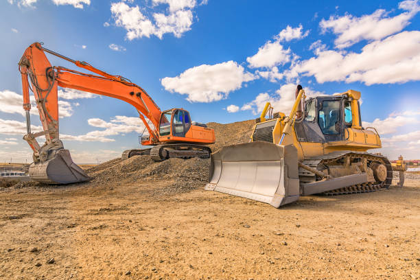 Heavy machinery in repair works of a motorway stock photo