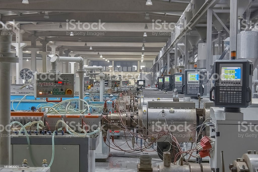 Heavy machines and displays in factory production line stock photo