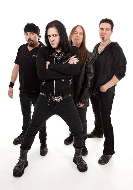 Heavy Metal Band Four guys in a heavy metal band posing. goth stock pictures, royalty-free photos & images