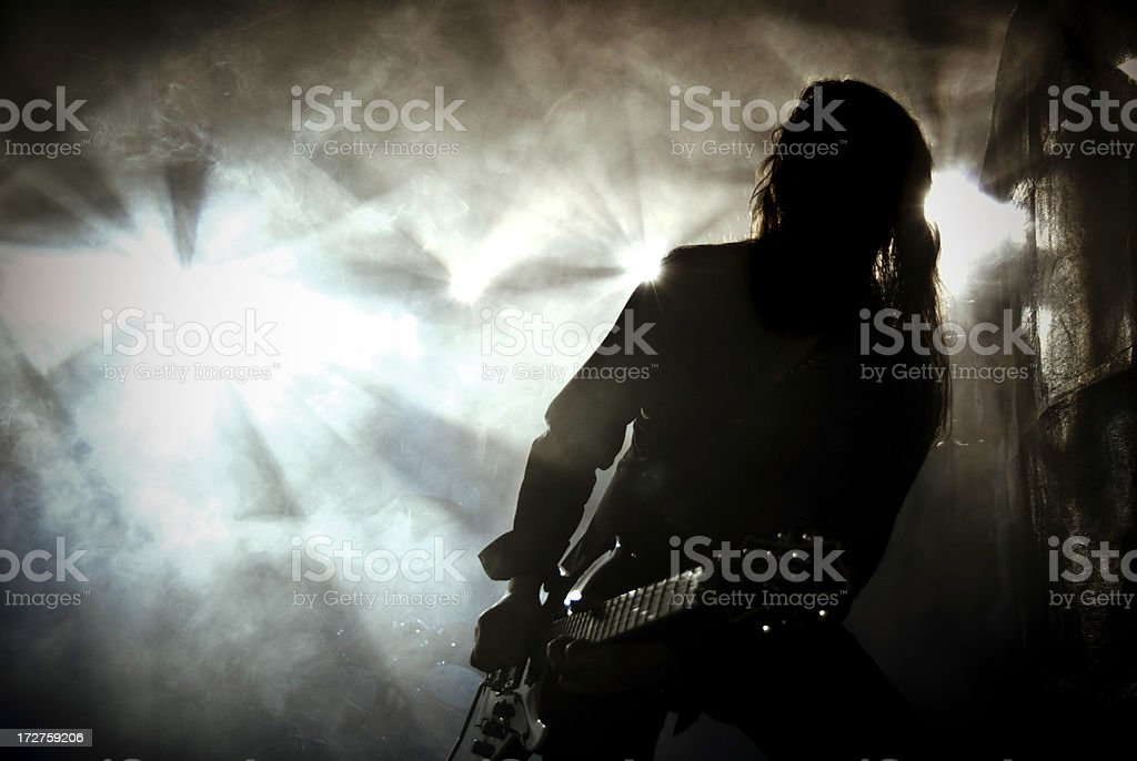 Heavy metal guitar player on stage with dramatic lights royalty-free stock photo