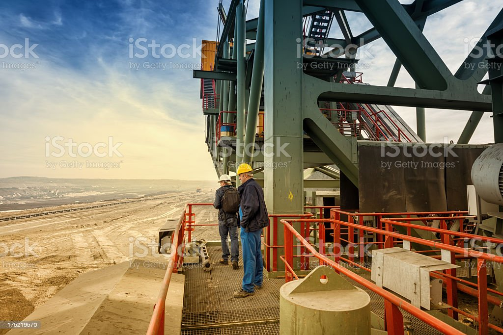 Heavy mining industry workers stock photo