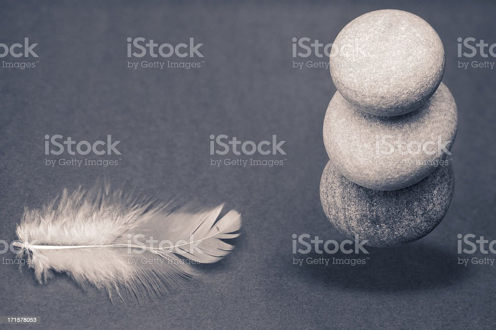 Heavy or light? Appearance or reality? Zen concept stock photo