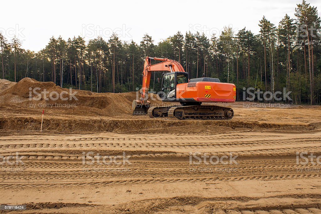heavy organge excavator stock photo