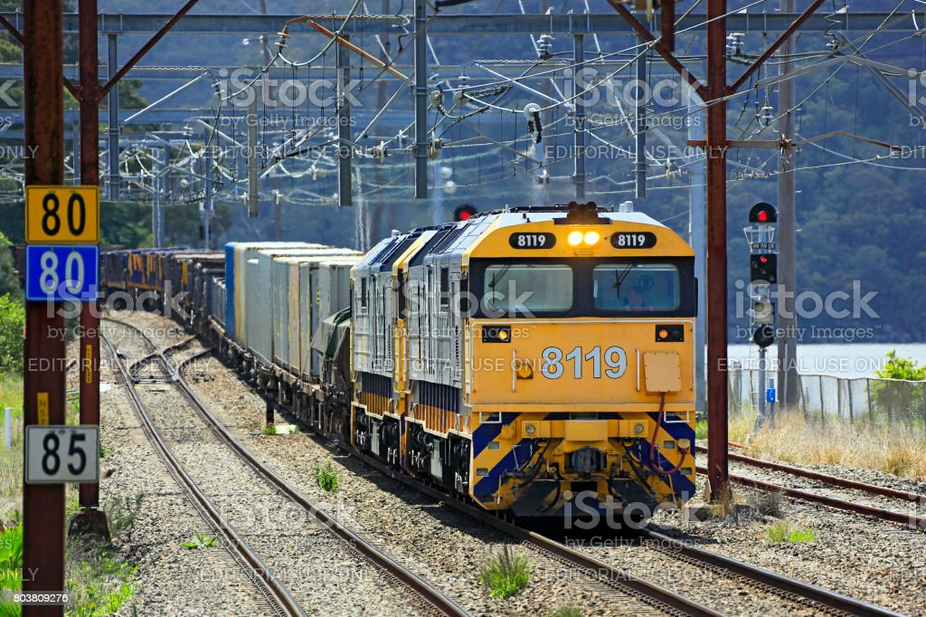 Heavy Pacific National diesel freight train in suburban Sydney stock photo