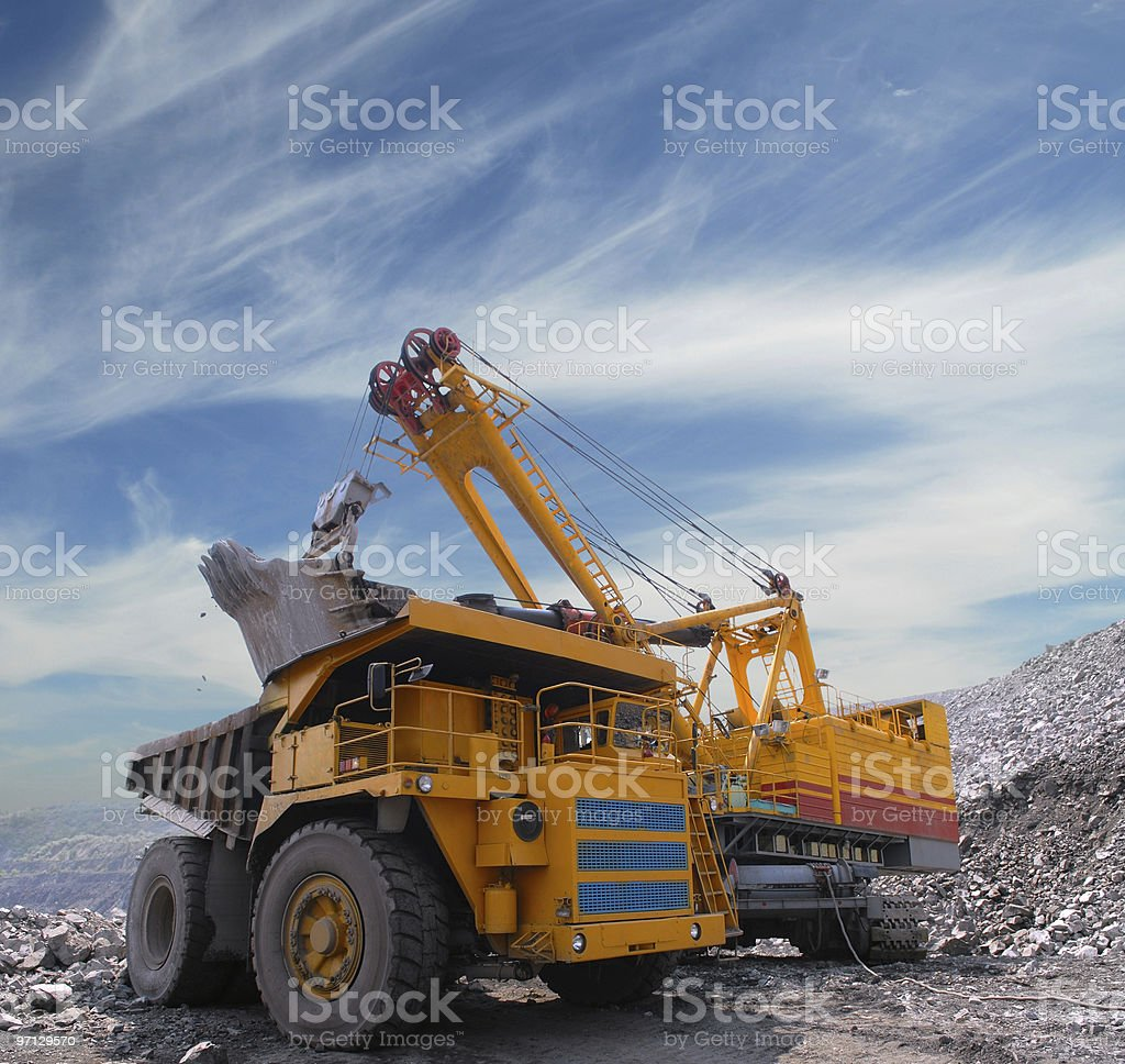 Heavy plant machinery loading iron ore in a quarry stock photo