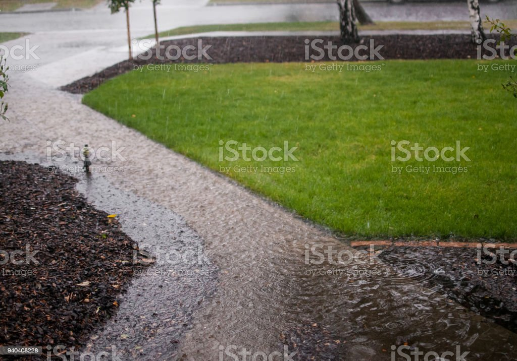 Heavy Rain Causing Flooding And Puddles Stock Photo & More Pictures