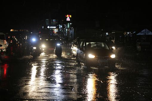 Beawar, Rajasthan, India, September 11, 2021: Vehicles wade through waterlogged road during heavy rain in Beawar.