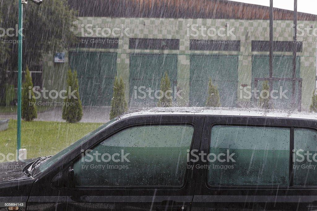 Heavy rain on car\'s roof