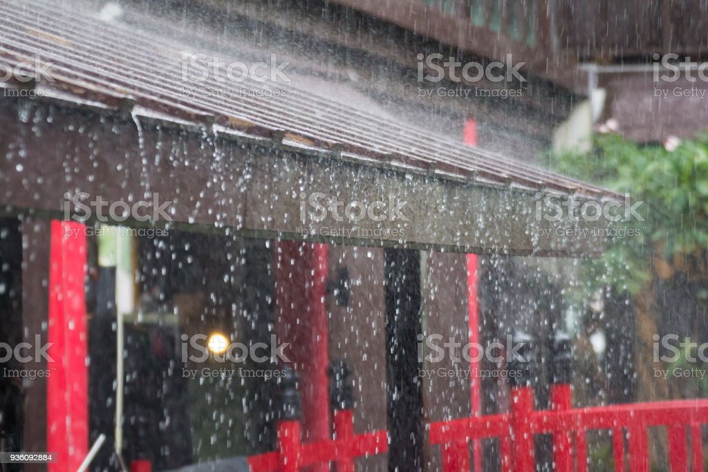 heavy rain on roof of japan house in rainy season