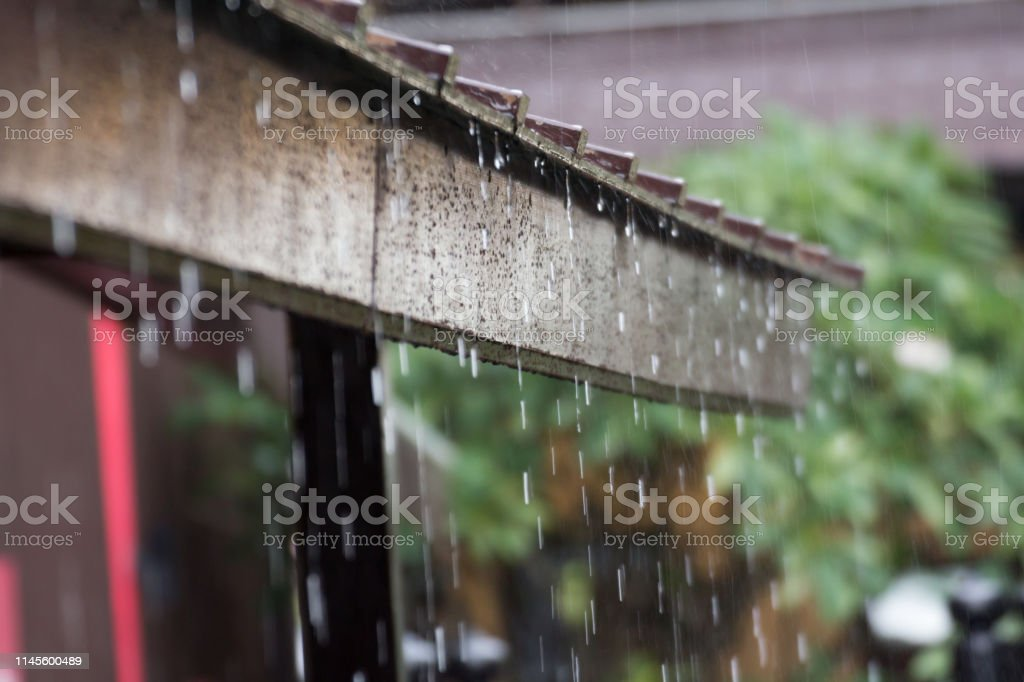 heavy rain on wooden roof, rainy season.