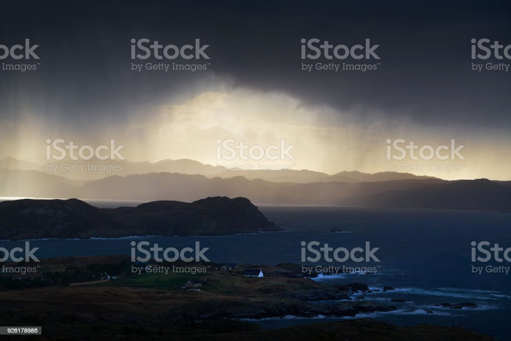 Heavy rain over coastal crofts at Loch Ewe, Scottish Highlands,...