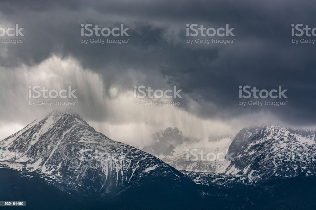 Heavy rain over mountains. Stormy weather. stock photo
