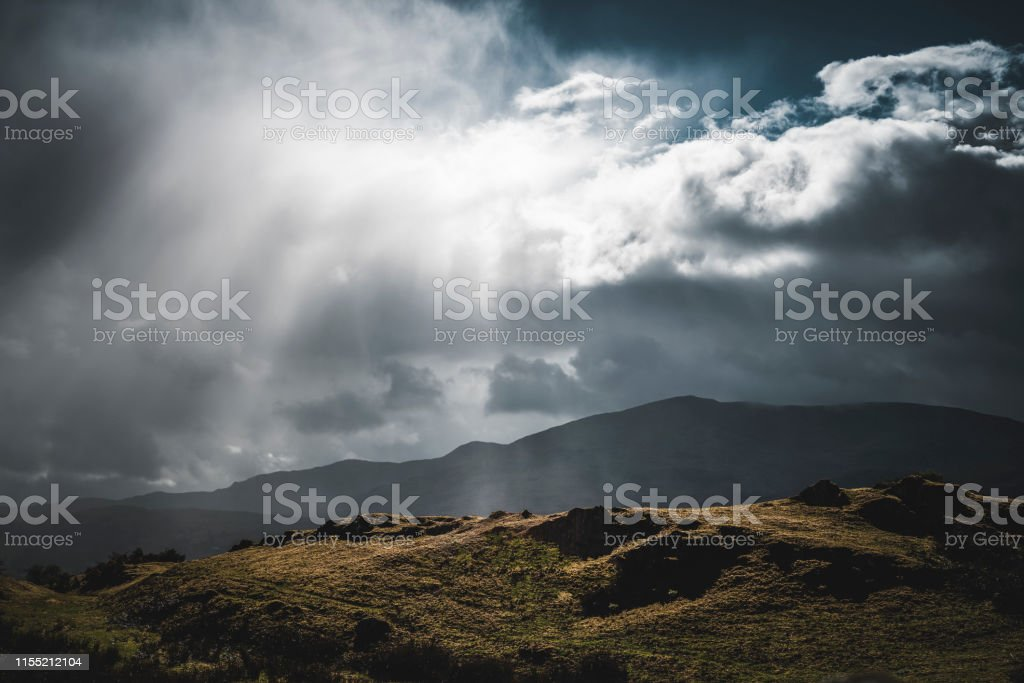 Heavy down pour of rain over the English countryside with storm clouds
